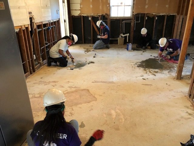 Students repairing flooring